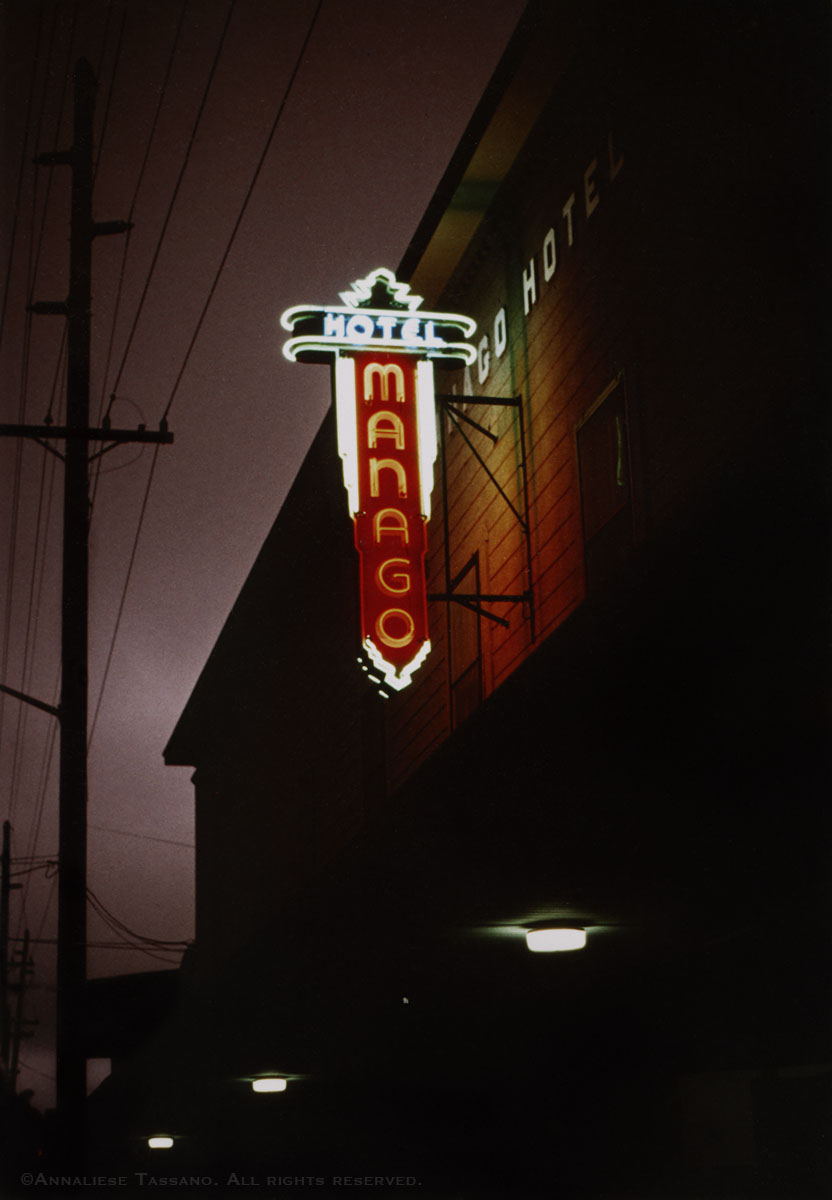 A night view of the vintage neon sign for the old Manago Hotel in Captain Cook, Big Island, Hawaii.